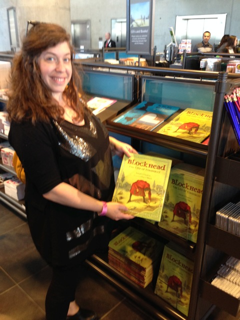 This was a cool. One of my bookseller friends, Caroline (above) spotted my Fibonacci book on sale (in copious quantities) at the  Salvador Dali Museum in St. Petersburg, Florida.  The artist Dali referenced the Fibonacci Sequence in many of his works. I love when one of my books connects with a museum gift shop. Their priorities are vastly different from traditional bookstores, and they'll keep a book in stock long after the other stores have returned them and moved on.  * * *  Meanwhile, Caroline's employer,  Malaprops , is in the news this evening. This   New York Times  article  announces that they are one of more than 50 indie bookstores that will receive a grant from mega-author James Patterson.