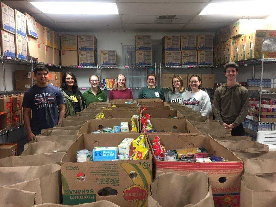 Students help fill bags at the food pantry