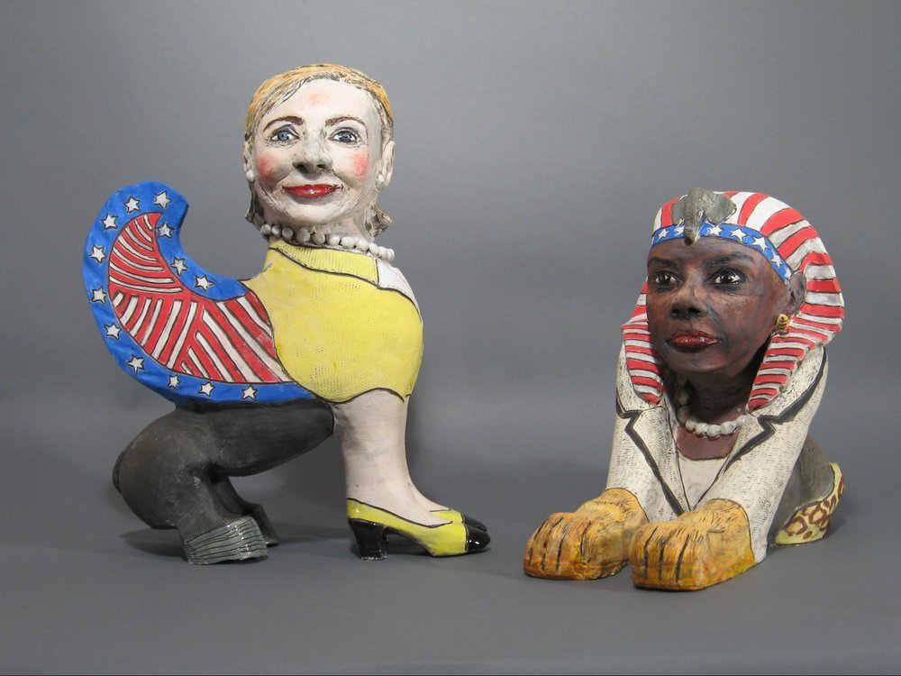 "Above:  Hillary Sphinx 2  and  Condoleezza Sphinx  by Cheryl Harper, 2008.  Hillary Sphinx 2   is 17"" h and in the Andrea Kirsh collection."