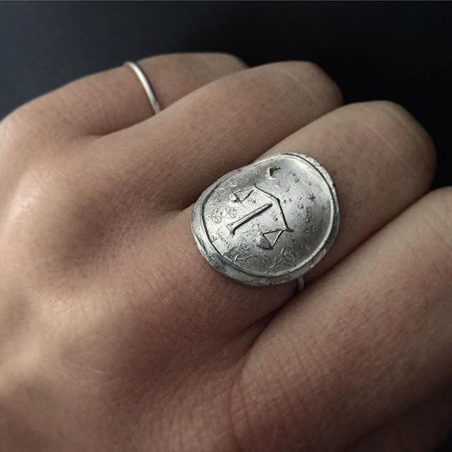 Really excited about this new collection I'm working on - hand carved and cast silver signet rings, this first one the Libra scales, with a tiny crescent moon and libra constellation in the sky, and roses around the ground, a symbolic flower for Libra. More to come with the other signs and their own unique flora.  #metalsmith #lucksmithmetals #handmadejewelry #handcraftedjewelry #etsy #etsyjewelry #differencemakesus #zodiac #constellation #libra #silversmith #silverring #signetring