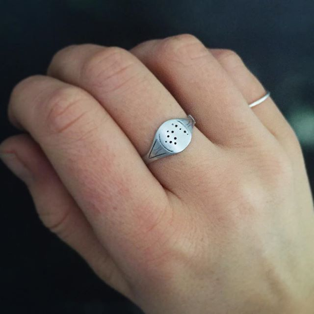 So many Aquarius pieces just sent out, but I snapped a shot of this signet ring before I packaged it up. Sterling silver, with the Aquarius constellation on the front and a subtle etched design inspired by an antique signet ring I found at an estate sale. Available in each sign in the Lucksmith Etsy shop - link in bio 🌌✨#metalsmith #silversmith #jewelry #handmade #jewelryoftheday #differencemakesus #etsyshop #etsy #etsyjewelry #aquarius #constellation #zodiac #jewelrydesigner