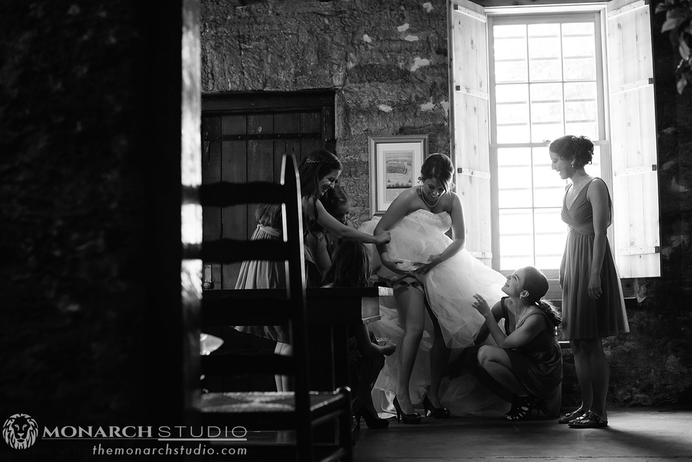Bride getting ready before wedding at St. Francis Barracks in Saint Augustine