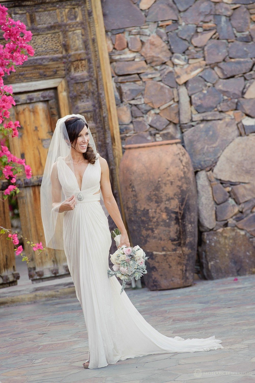 Beautiful bridal portrait with soft muted color palette flower bouquet.