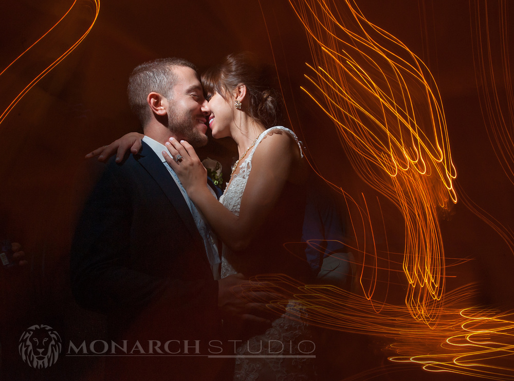 Light dances with Kyle and Samantha on their wedding at the Whiteroom