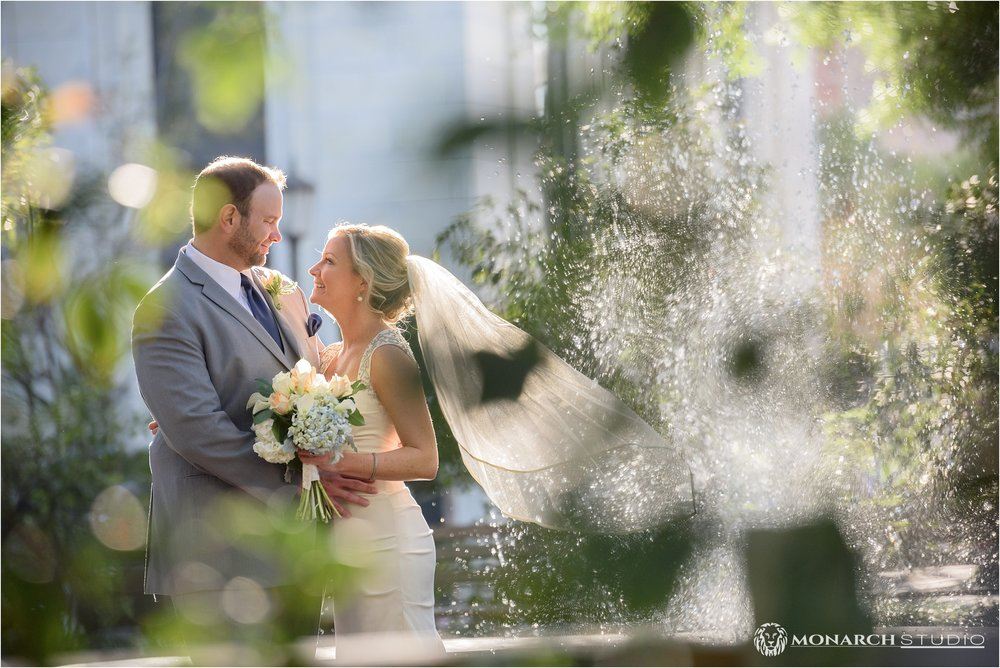 Travis and Shae share a moment by one of Savannah's beautiful park squares.