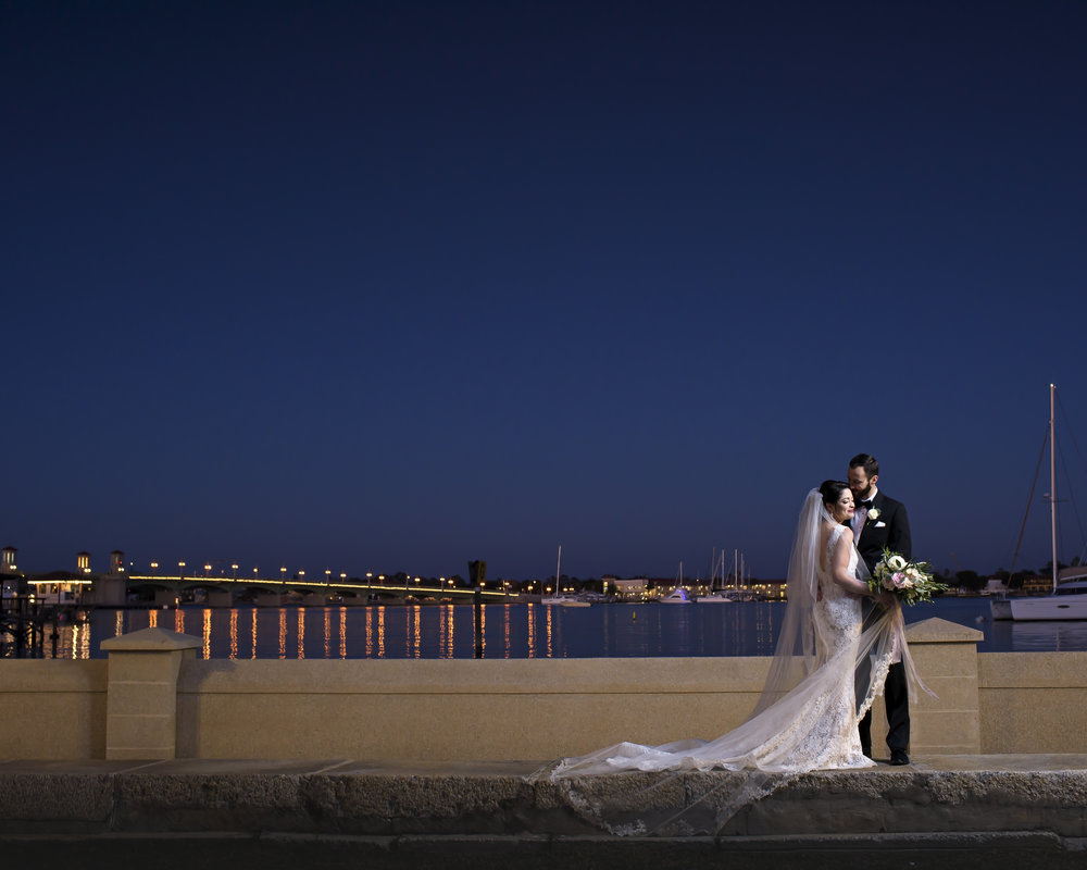 Kimberly and Tyler share a serene moment overlooking the historic Bridge of Lions