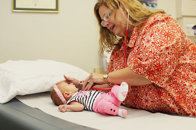 Pictured: Dr. Rhonda Green treats a young patient at South Central Kansas Clinic. The clinic is a subsidiary of the hospital and a part of SCKMC's physician recruitment strategy that could be assisted with sales tax revenue if a one-half cent increase is voted in during the November election.