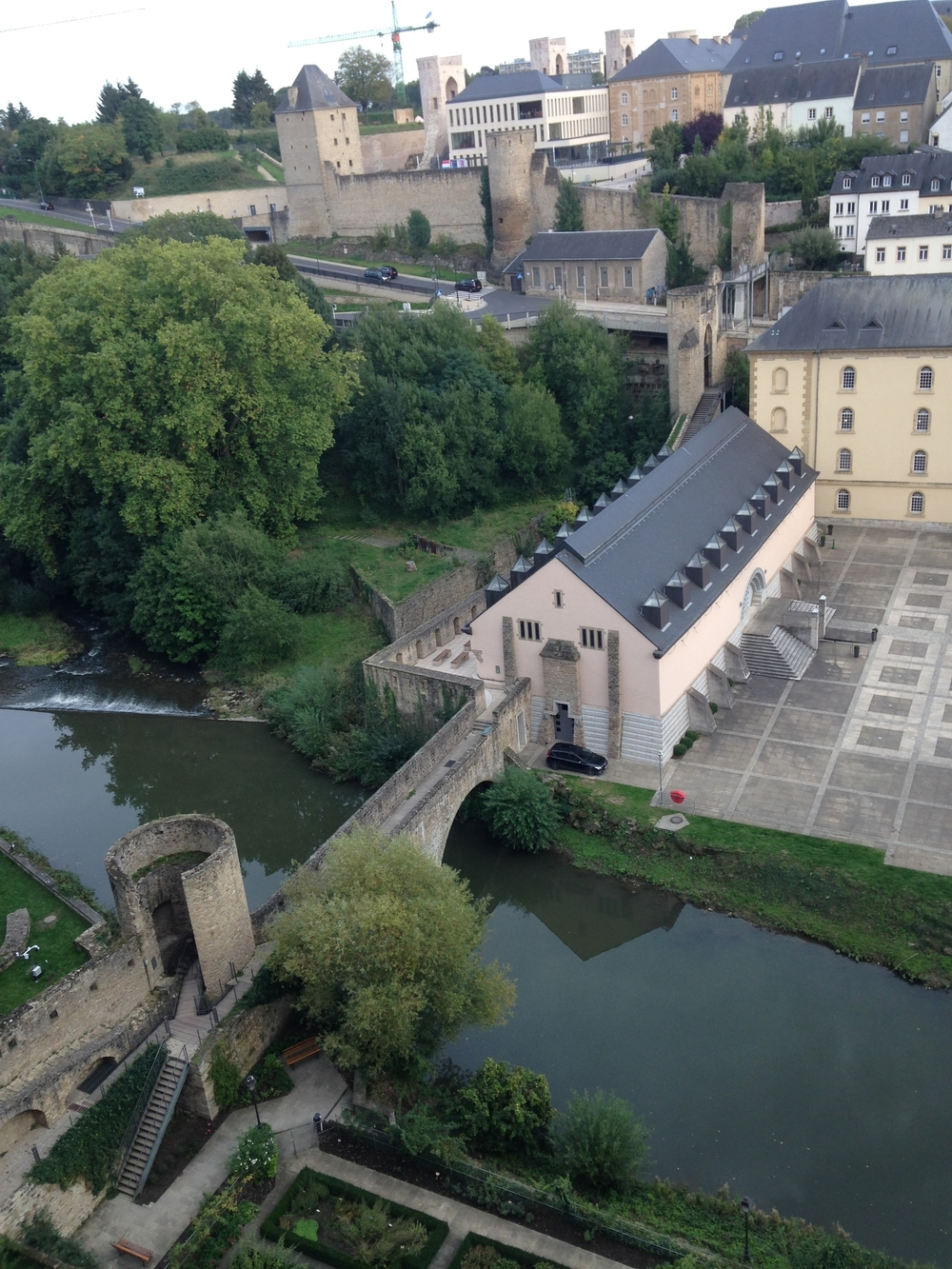 The medieval fortifications are just part of the fabric of the city. Yesterday morning my walk to the office went across this bridge and down the tower stairs. Nice embrasure placements, by the way. Good coverage of the river approach.