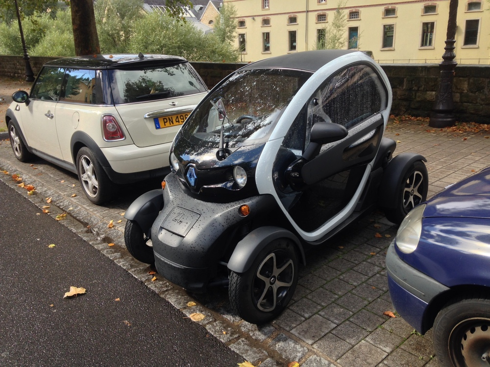 Holy cow, it's a Twizy! I hadn't seen one in person before. Plug-in electric, technically a two-seater (front and back, although I don't imagine an adult would be too happy in the back). And parks sideways.