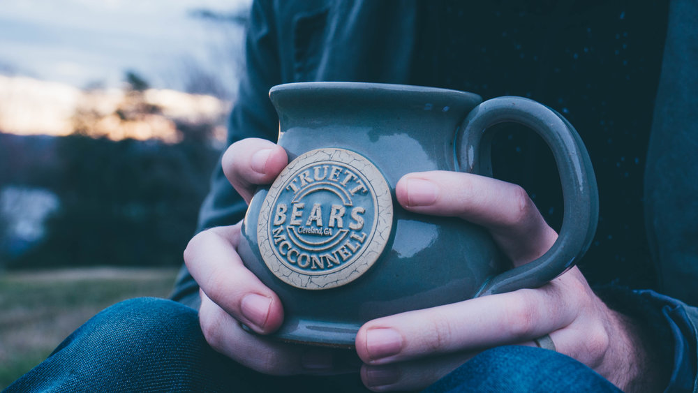 Sunset Hill Mugs - This piece has been handmade by a Wisconsin artisan. Its distinctive character is a combination of yesteryear art, modernized for today's living.