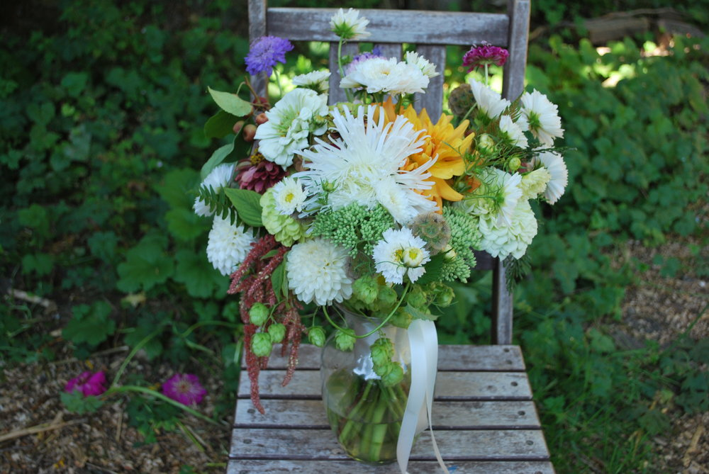 August bridal bouquet - hops, aster, cosmos, ferns, dahlias, amaranth, scabiosa, & sedum.