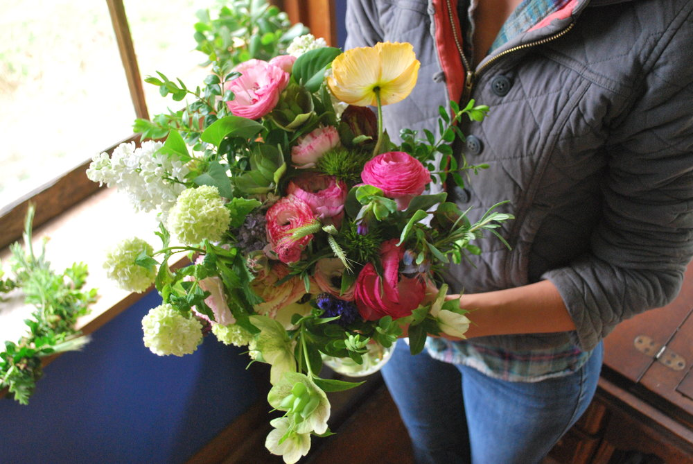 April bridal bouquet - hellebore, viburnum, ranunculus, hydrangea, poppies.