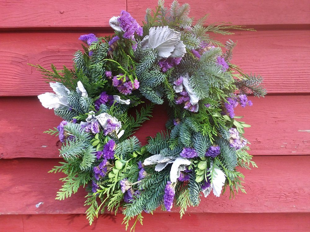 Evergreen and dried flower wreath