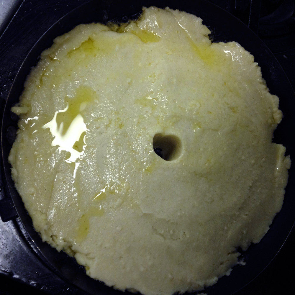 "The corn flour ""pizza"" shortly after it went into the pan, a steam vent was poked with the handle of a wooden spoon"