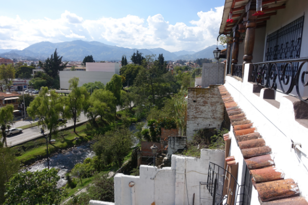Looking down on one of Cuenca's riverwalks and the surrounding mountains