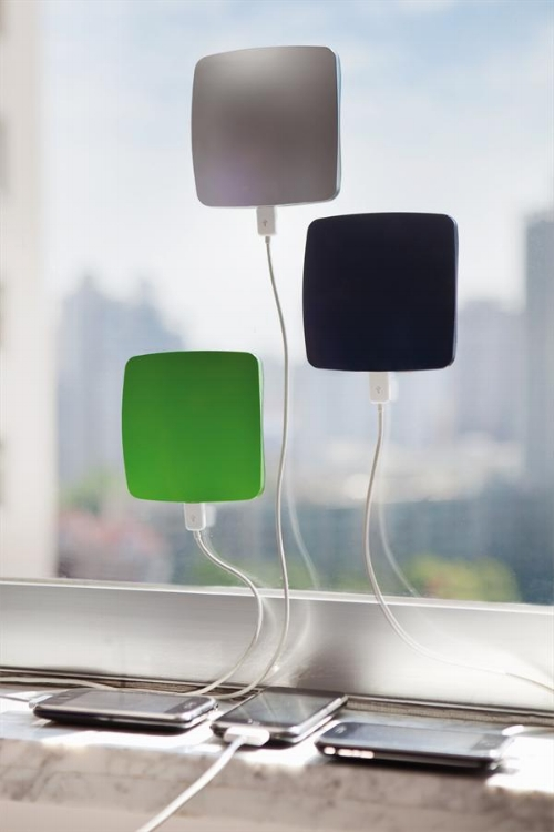 These solar chargers stick to your window and can charge an iPhone in about 5 hours - not electricity necessary.