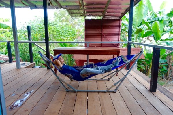Lounging on the porch of an Airbnb in Siem Reap, Cambodia
