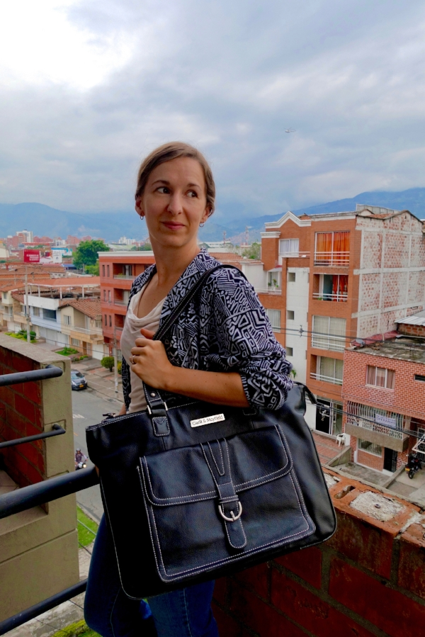 Michelle with her Stafford Pro bag on the balcony of their apartment in Medellín