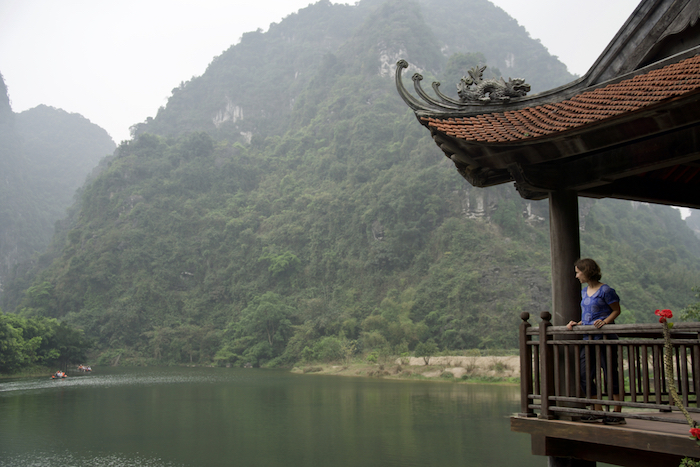 A hidden riverside temple accessible via rowboat in Trang An