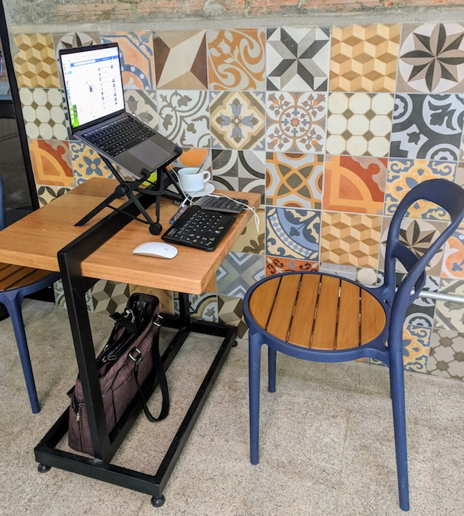 Michelle's portable desk at Selina Coworking