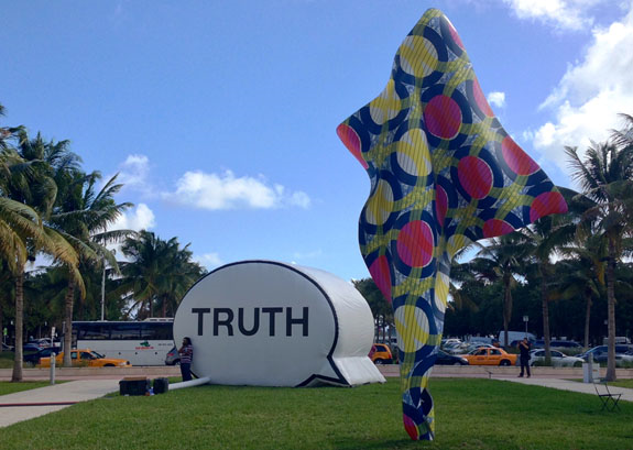 Hank Willis Thomas, Ryan Alexiev and Jim Ricks In Search of Truth (The Truth Booth), 2011 and Yinka Shonibare MBE Wind Sculpture IV, 2013.