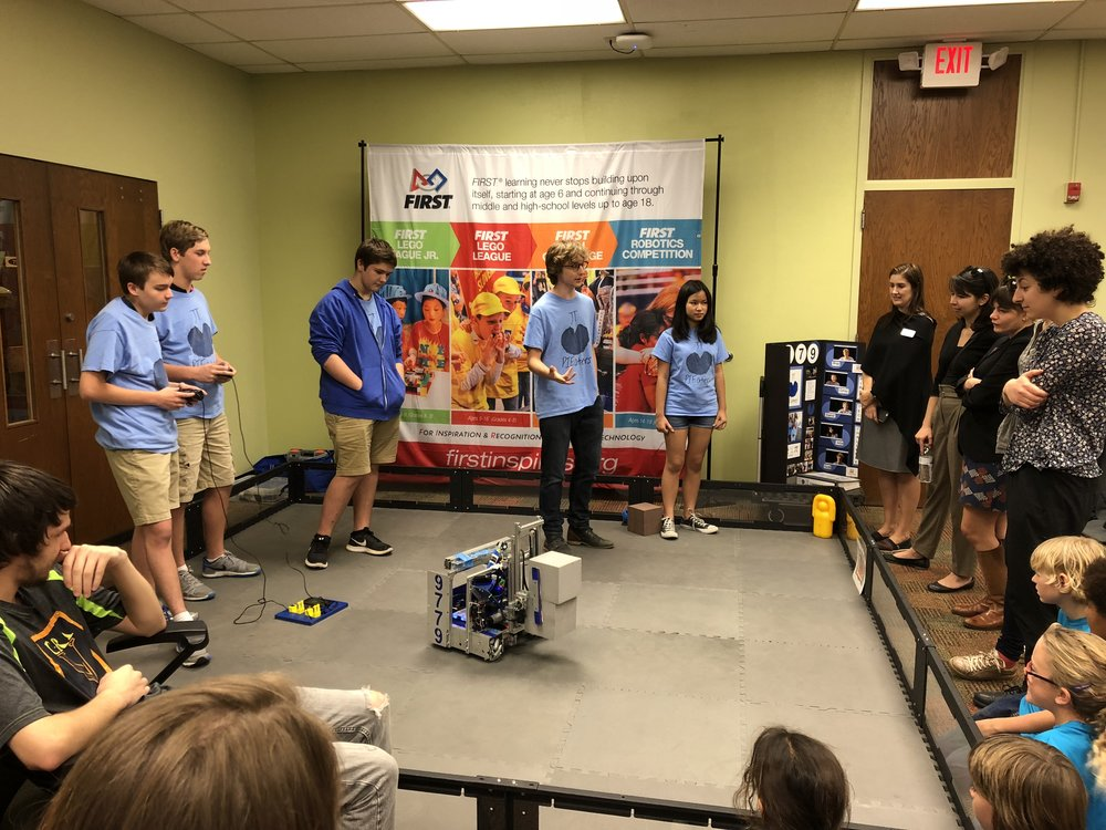 FIRST ® Tech Challenge (grades 7 to 12) students show off their custom designed, engineered, and built robot as it picks up cubes for distribution or placement on the field as a part of this season's game.
