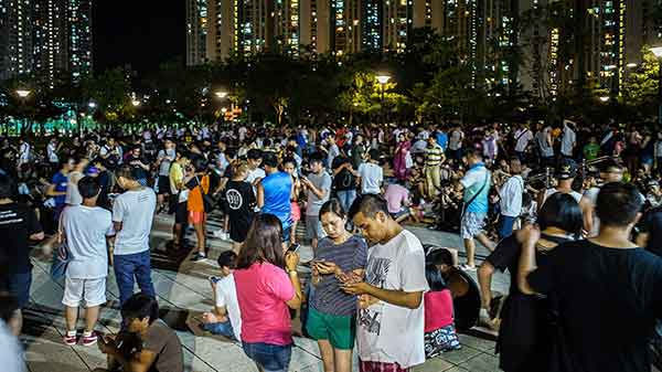 People play the Pokémon GO game at a park at Tin Shui Wai on July 26, 2016 in Hong Kong. Photo: Lam Yik Fei/ Getty Images