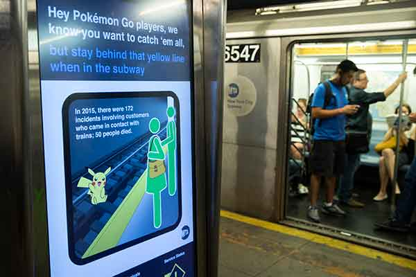The NYC Metropolitan Transit Authority courteously reminds passengers not to jump onto the subway train tracks to catch Pikachu, because there's a 29% chance of death. Photo: Drew Angerer/ Getty Images