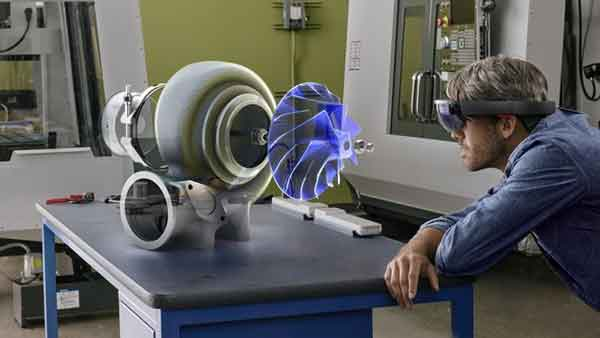 Why wait to 3D print a prototype when mixed reality allows you to see and manipulate a part in a real work environment?  Image: Microsoft