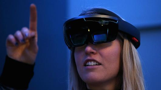 Getty Images  Microsoft employee Gillian Pennington demonstrates the Microsoft HoloLens augmented reality (AR) viewer during the 2016 Microsoft Build Developer Conference on March 30, 2016 in San Francisco, California.