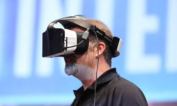 Intel technical marketing engineer Craig Raymond demonstrating the Project Alloy virtual reality headset. Photograph: Intel/EPA