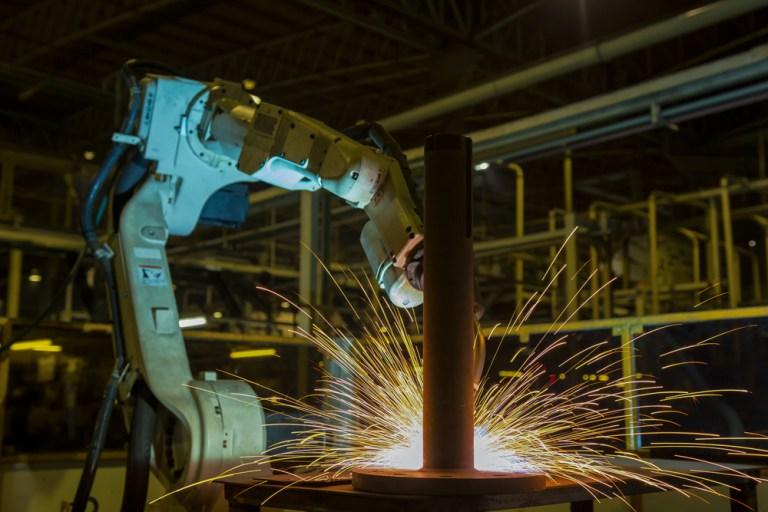 A robot welding an automotive part. Factory_Easy/Shutterstock
