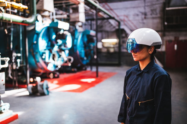The DAQRI Smart Helmet projects instructions on machinery to let people work hands-free.