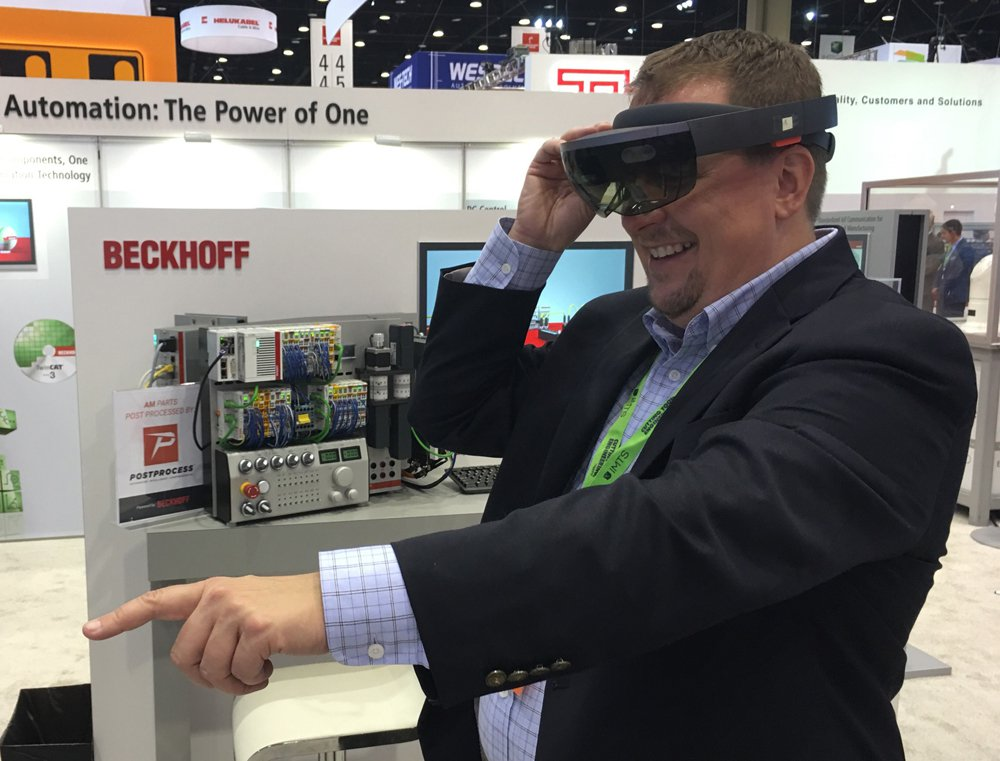 Just for fun: Yours truely checking out Microsoft HoloLens proof-of-concept connected to Beckhoff Automation's IOT demo at IMTS in Chicago.