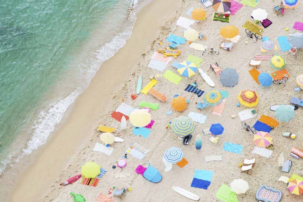 Gray malin has command of the pink, green, and blue colors of the ocean and beach captured in delightful scenes shot from overhead.