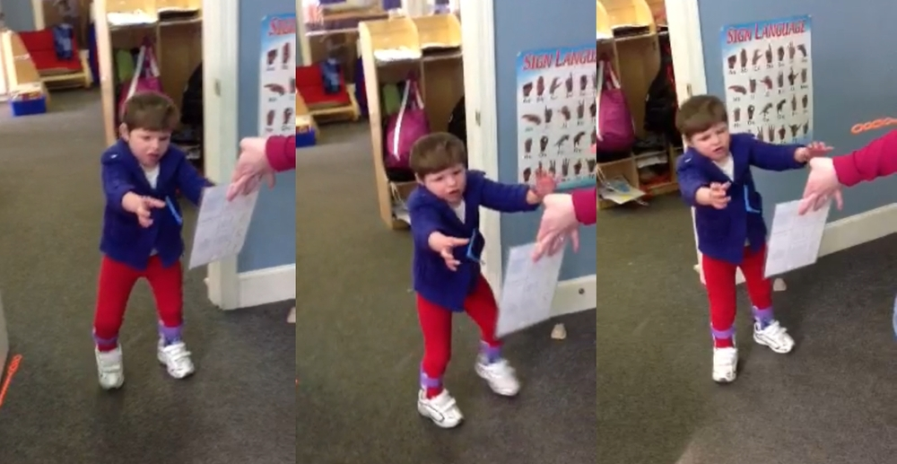 "T walking at school the other day, recorded by her teacher. She might as well be giving the finger to the camera, as if to say, ""Don't get your hopes up, Dad--I won't be doing this at home."""