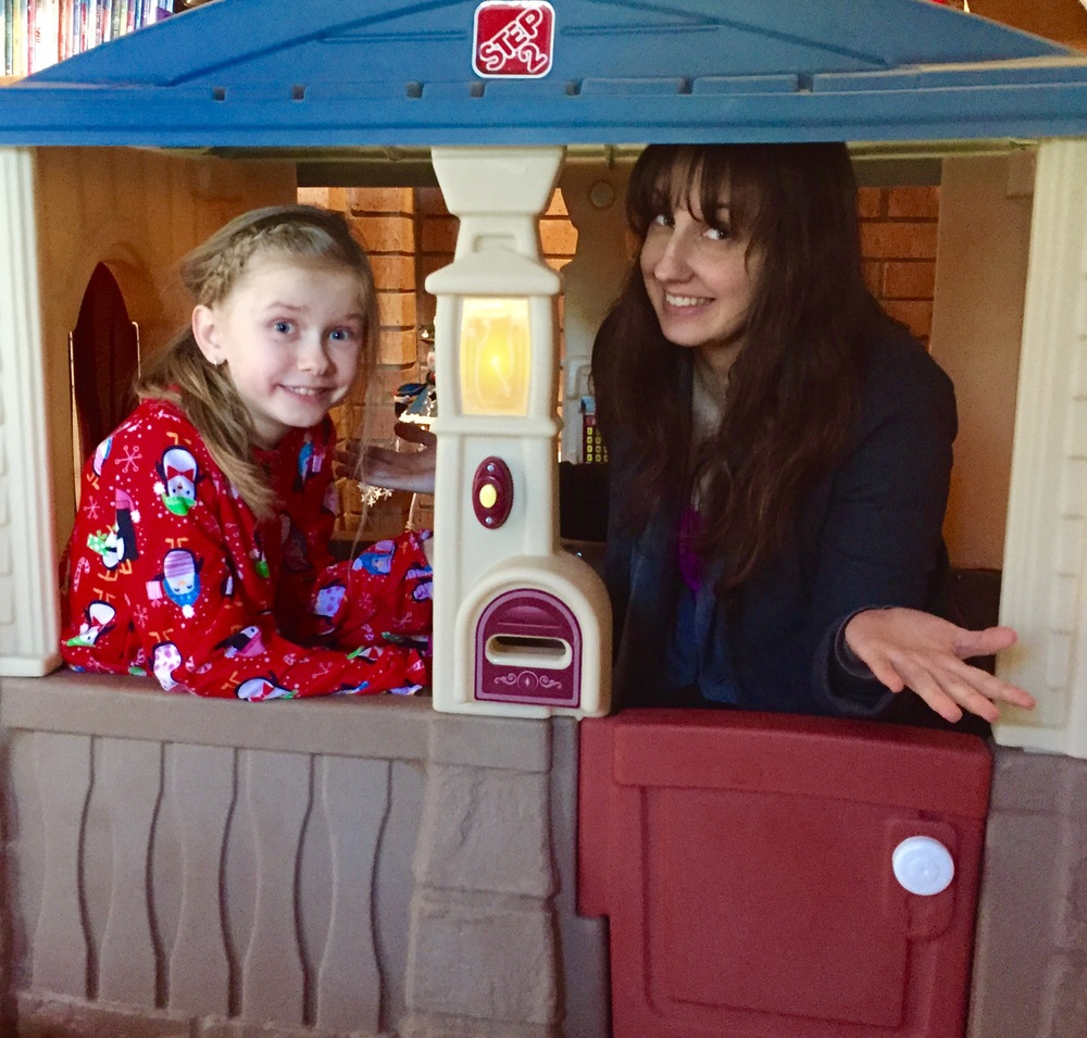 That's me on the right, coaxed into a playhouse by my niece Maggie.  Two observations: 1) Little kid playhouses are SMALL…yet surprisingly cozy. 2) Crawling in is way easier than crawling out.    Interpret as you will.