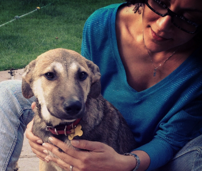 Co-founder Nadine with one of her rescue dogs from Romania