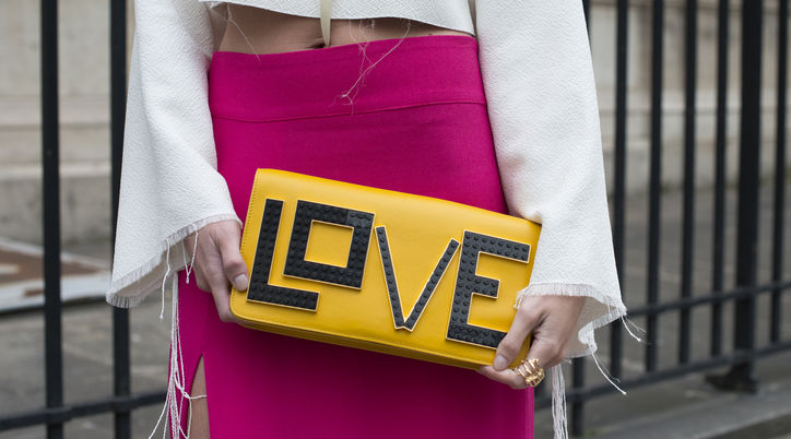 glamour :     It must be love. (via  Statement Clutches That Actually Say Something: Dressed: glamour.com )     Ok - I am LOVING this clutch! So fun, colorful, and does truly make a  statement!