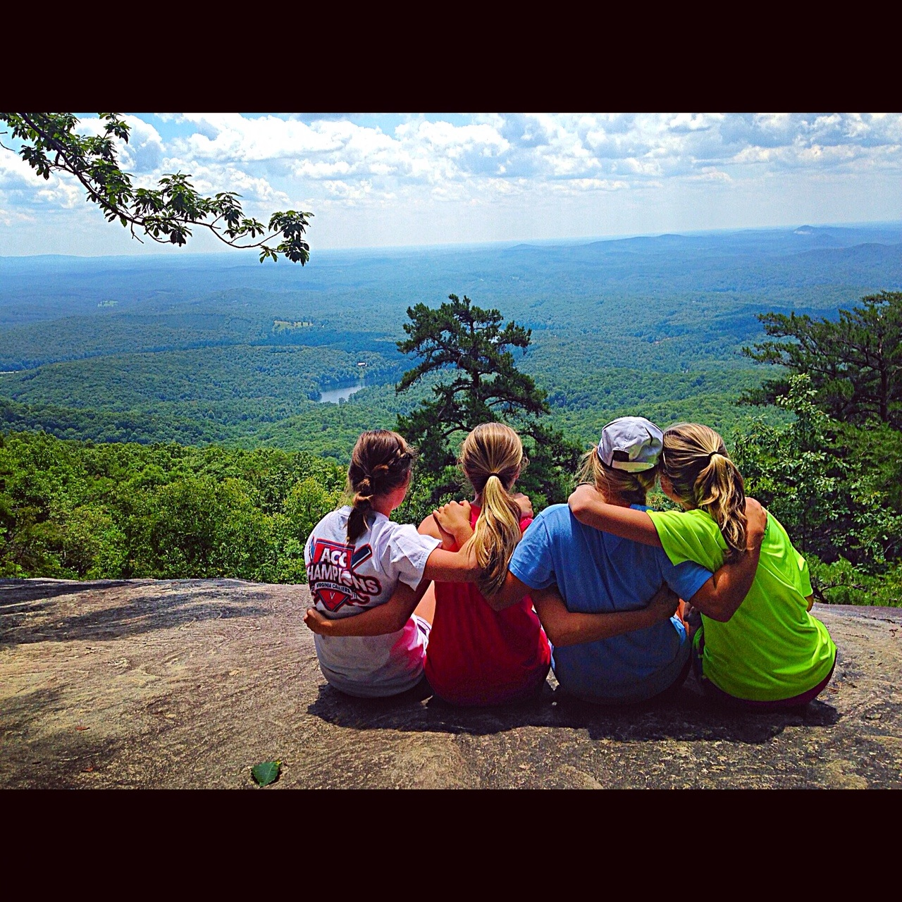 There are no words for these type places   As we continue to write about various Words and Places this summer, I share this photo of four special teens who are close to my heart.  While camping, we hiked toward the top of Table Rock State Park last week in an effort to get some exercise and get to know one another better.  Both were achieved. Why is it we need to leave home to discover ourselves? Is it because we locked our cell phones in the car? Is it because the awe of being up high took our breath away (literally -  smile )? Or is it as simple as being free from the same four walls we confine ourselves in each day?  Look at this picture again…. I see girls hugging, resting, taking in both the beauty before them and the beauty next to them.  Sometimes the unspoken words are the only ones you need.