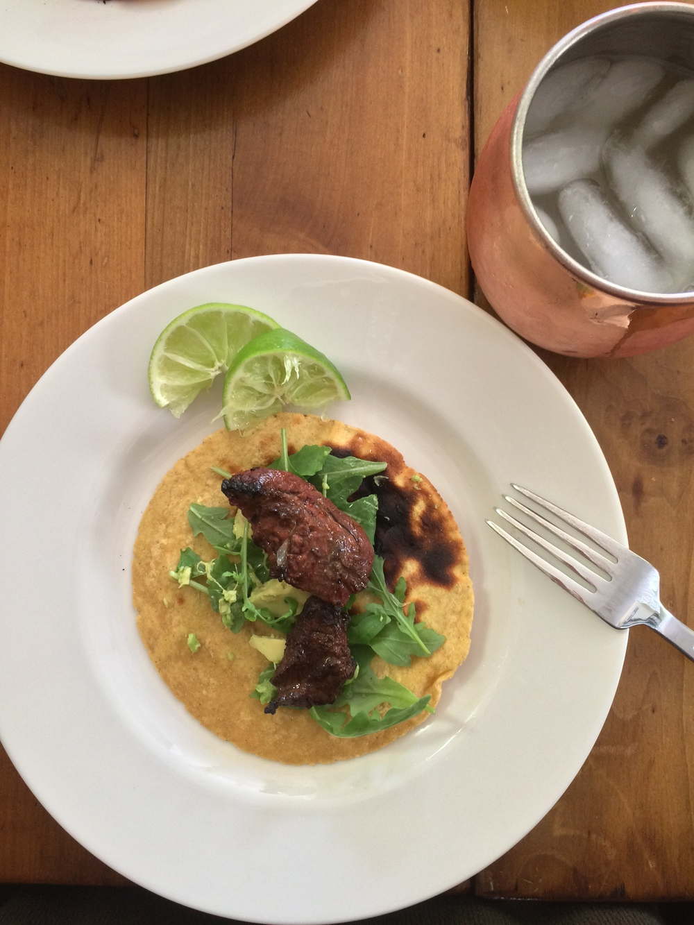 I like my steak tacos with arugula, avocado and a little bit of fresh lime juice - so delicious!