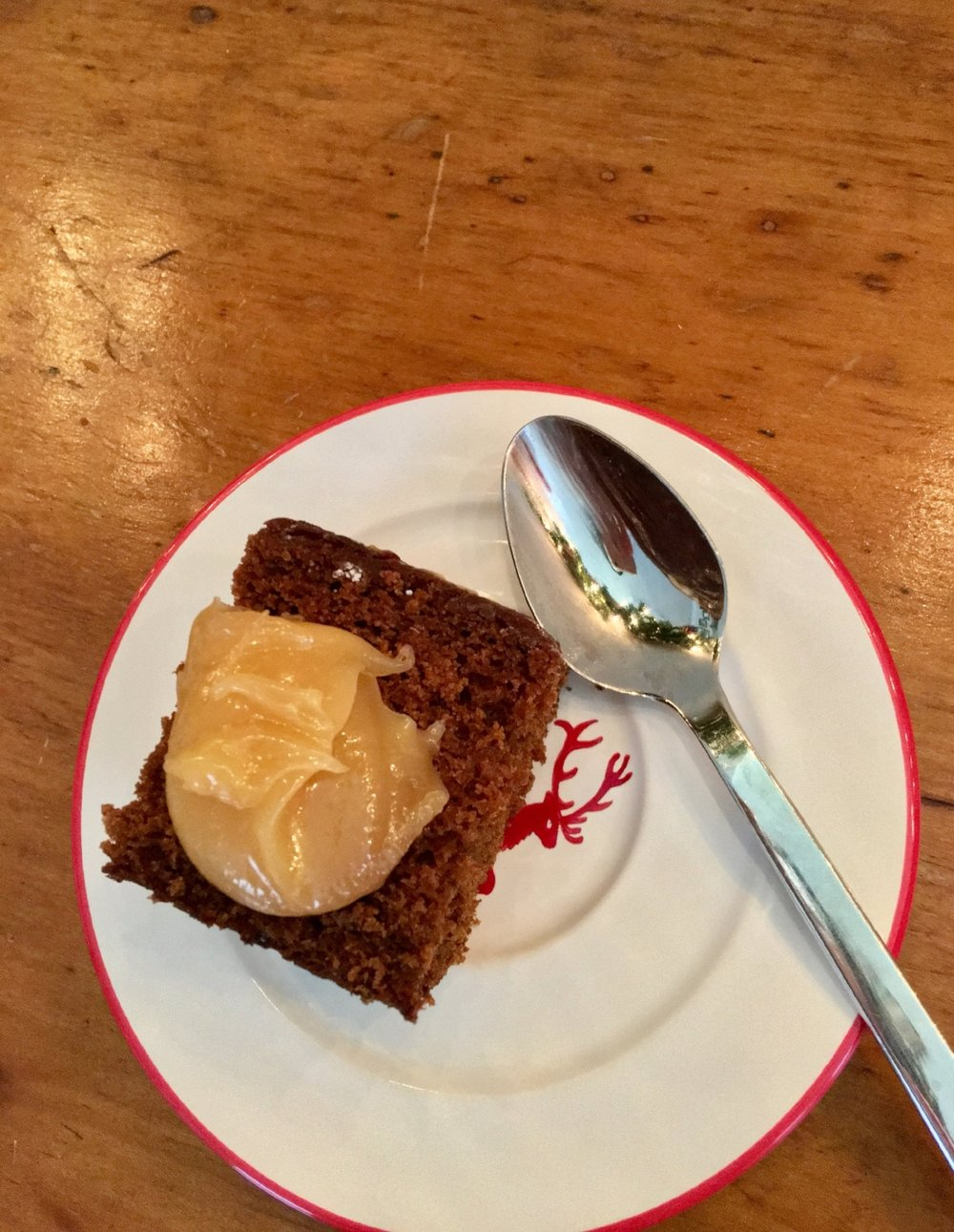 That dollop of lemon curd is so tart - I love how it combines with the spicy flavor of the gingerbread cake! And this sweet little red-rimmed plate with a reindeer in the center is part of a set Kurt and I were given as a wedding gift. I love to use them during the holiday season!