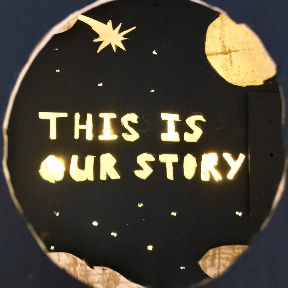 """The cover of the book - a night sky with the words """"This Is Our Story"""" illuminated."""