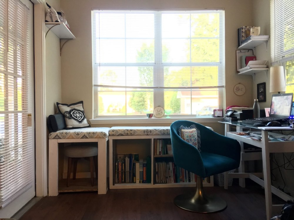 My complete office space - with plenty of natural light, a comfy chair to work from, and SO MUCH storage as a result of the storage bench!