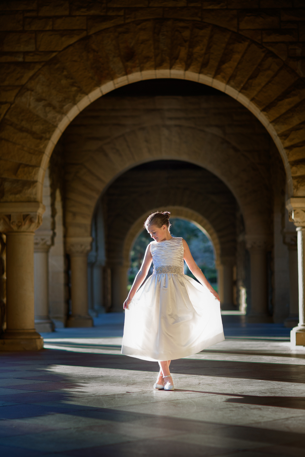 first communion photo under arch by photographer Abel Sanchez.jpg