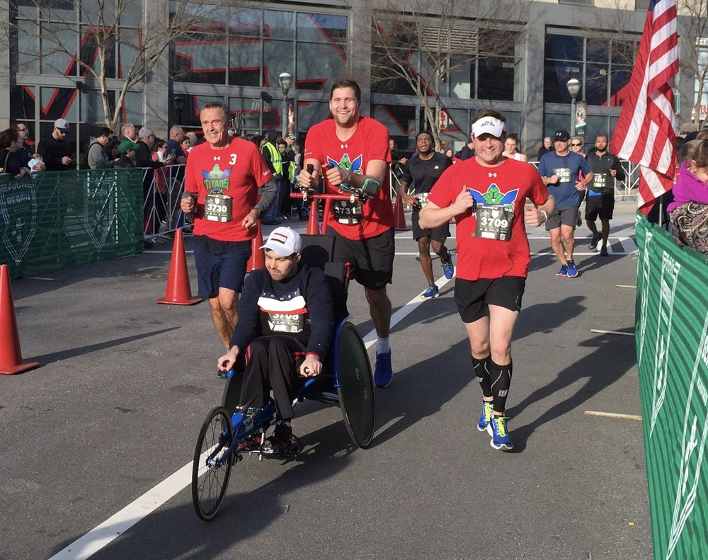 Team Matt Crosses Finish Line.jpg
