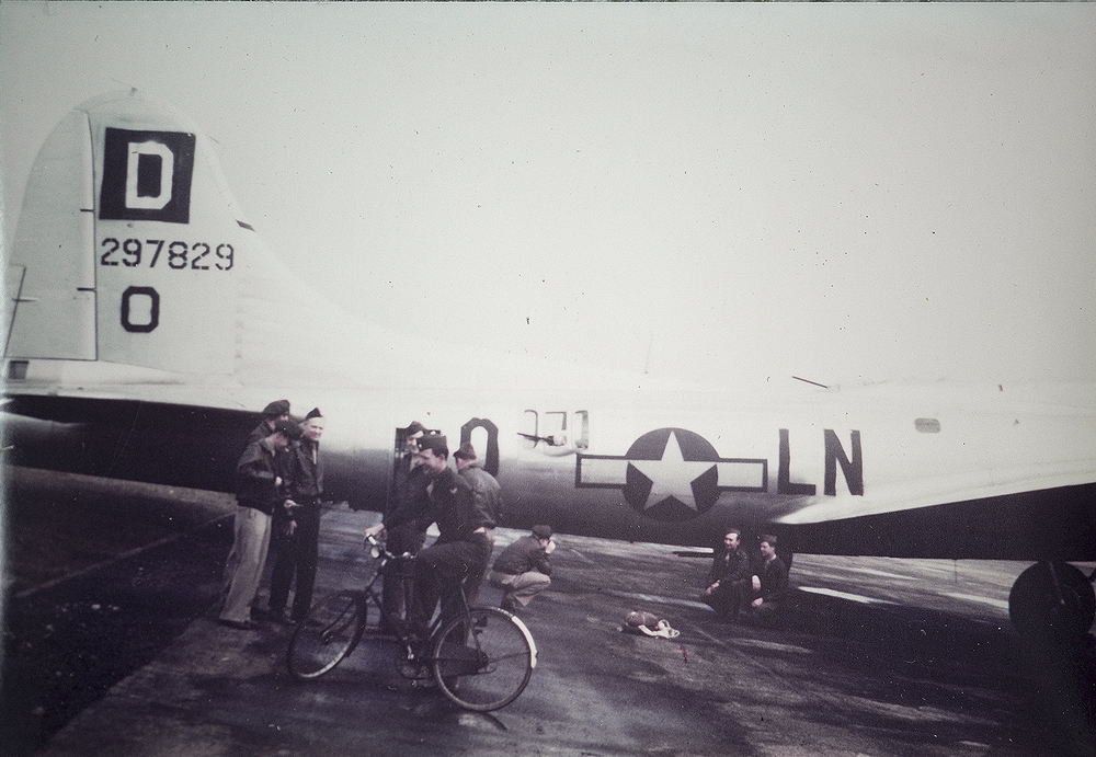 "Ground crew and Bomber crew of the 350th Bomb Squadron of the 100th Bomb Group following a combat mission.  From Honored Veteran Frank ""Bud"" Buschmeier's personal collection."