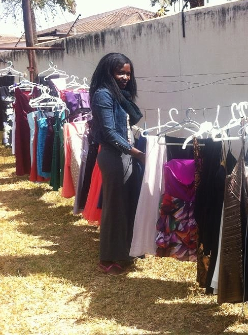(July 1, 2015) Malawian Sales Member and Livingstonia University student, Rebeeca Chinseu, organizes dresses (including Megan's dress!) for her Lilongwe Dress Party, where she will sell the dresses to earn a commission and support the education of young Malawian girls.