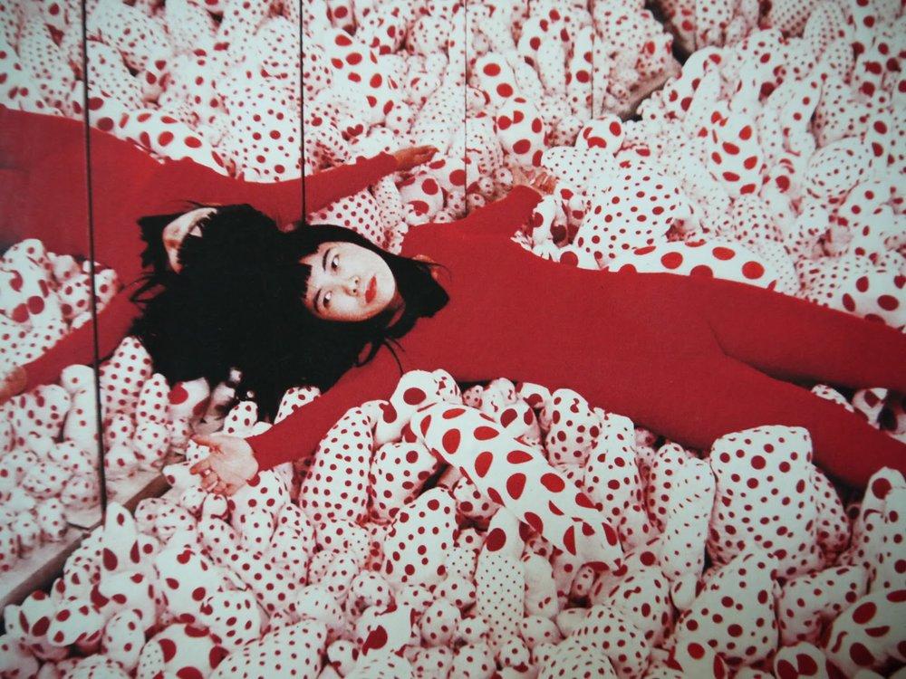 Young Yayoi and her polka dot world.  https://daily-dose-of-art.com/2014/11/12/dotermination-2-the-polka-dot-art-of-yayoi-kusama/
