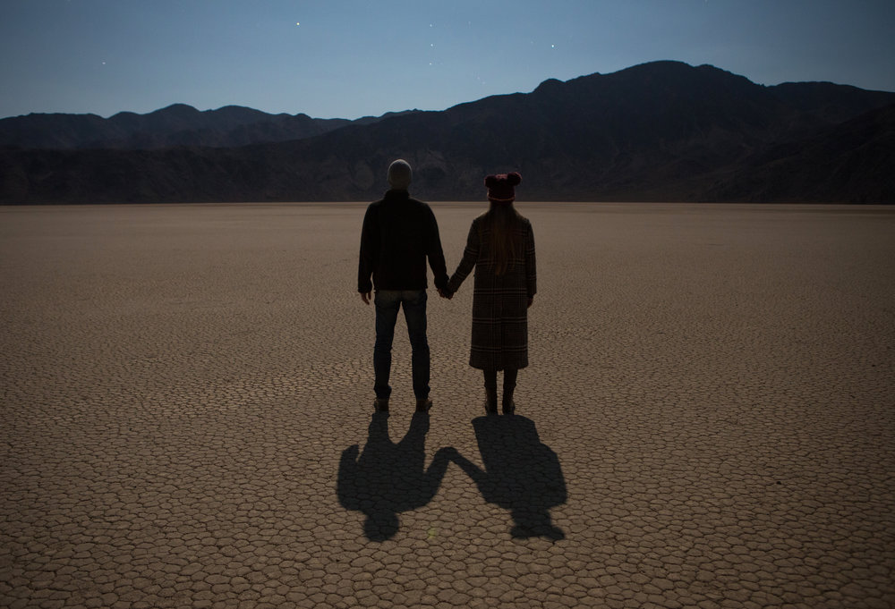 AstroBandit_DariusTwin_Racetrack_Playa_Long_Exposure_Stars_Couple_HoldingHands_1.jpg